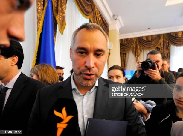 Ukraine's prosecutorgeneral Ruslan Ryaboshapka speaks to reporters after a press conference in Kiev on October 4 2019 Ukraine's prosecutorgeneral...