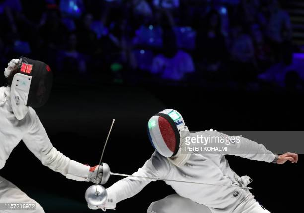 Ukraine's Roman Svichkar and France's Ronan Gustin compete during the Men's Epee team final at the 2019 Fencing World Championships in Budapest...