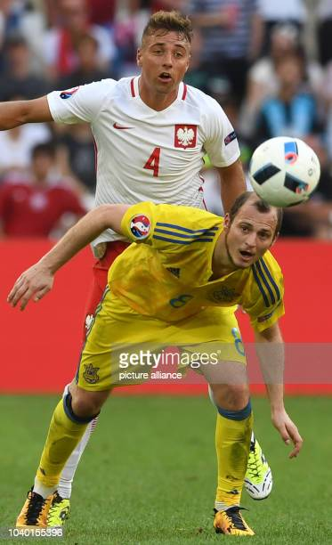Ukraine's Roman Zozulya and Poland's Thiago Cionek challenge for the ball during the UEFA Euro 2016 Group C preliminary round soccer match between...