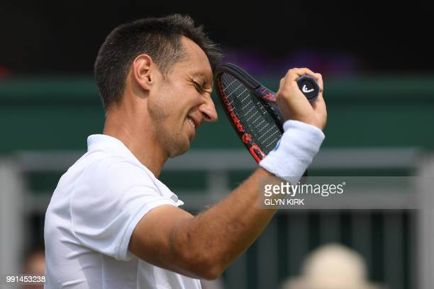 Ukraine's Sergiy Stakhovsky reacts while playing US player Sam Querrey during their men's singles second round match on the third day of the 2018...