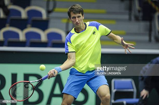 Ukraine's Sergiy Stakhovsky returns the ball to Sweden's Johan Brunstrom during the first single match in the second round of the Davis Cup...