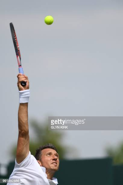 Ukraine's Sergiy Stakhovsky serves to US player Sam Querrey during their men's singles second round match on the third day of the 2018 Wimbledon...