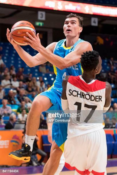 Ukraine's shooting guard Maksym Pustozvonov drives to the basket as Germany's point guard Dennis Schroder during the FIBA EuroBasket 2017 basketball...