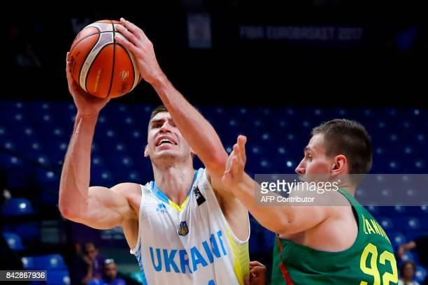 Ukraine's shooting guard Oleksandr Lypovyy catches the ball as Lithuania's small forward Edgaras Ulanovas defends during the FIBA EuroBasket 2017...