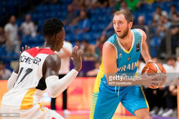 Ukraine's shooting guard Ruslan Otverchenko is marked by Germany's point guard Dennis Schroder during the FIBA EuroBasket 2017 basketball...