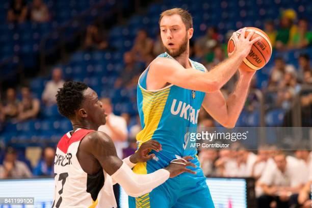 Ukraine's shooting guard Ruslan Otverchenko is marked by Germany's point guard Dennis Schroder during the FIBA EuroBasket 2017 basketball...