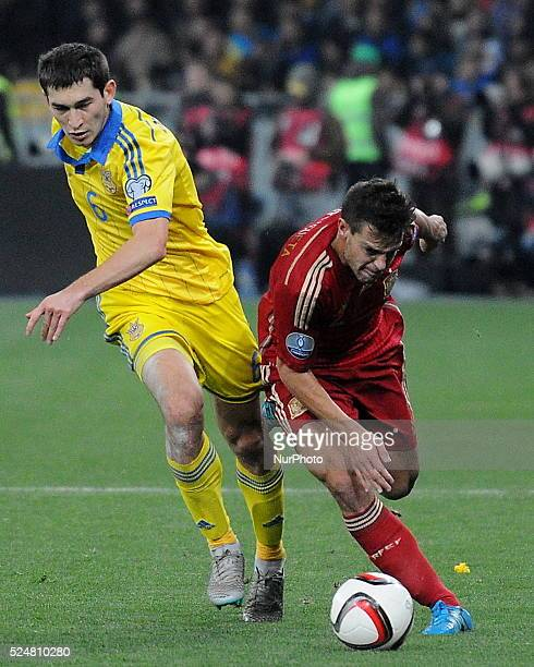 Ukraine's Taras Stepanenko left and Spain's Cesar Azpilicueta right fight for the ball during a the Euro 2016 qualifying match between the national...