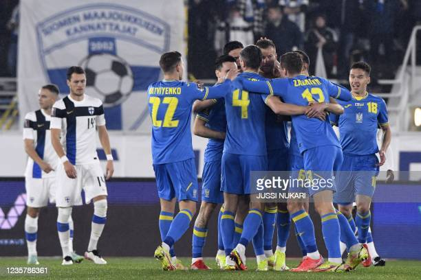 Ukraine's team celebrate scoring the opening goal during the FIFA World Cup Qatar 2022 qualification Group D football match between Finland and...