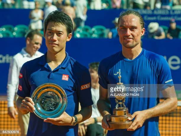 Ukraine's tennis player Alexandr Dolgopolov and runner up Japan's Kei Nishikori pose with their respective trophies after the final of the Argentina...