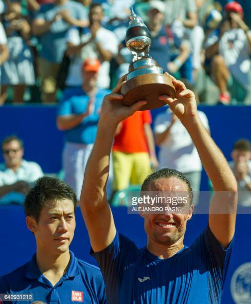 Ukraine's tennis player Alexandr Dolgopolov poses with his trophy after defeating Japan's Kei Nishikori in the final of the Argentina Open at the...