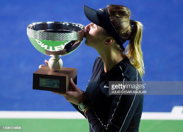 TOPSHOT Ukraine's tennis player Elina Svitolina kisses the trophy after winning the Monterrey WTA Open women's final singles tennis match against...