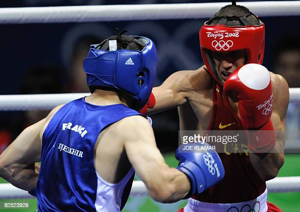 Ukraine's Vasyl Lomachenko fights against France's Khedafi Djelkhir during their Beijing 2008 Olympic Games Featherweight final boxing bout on August...