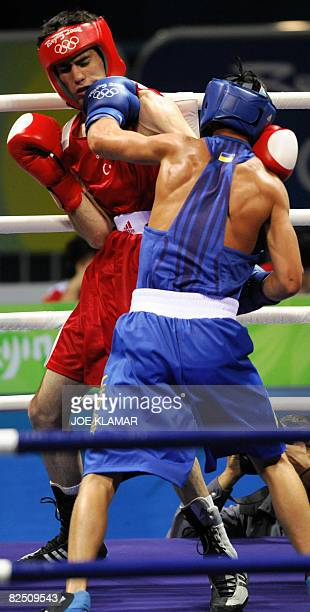 Ukraine's Vasyl Lomachenko fights against Turkey's Yakup Kilicduring their Beijing 2008 Olympic Games Featherweight semifinal boxing bout on August...