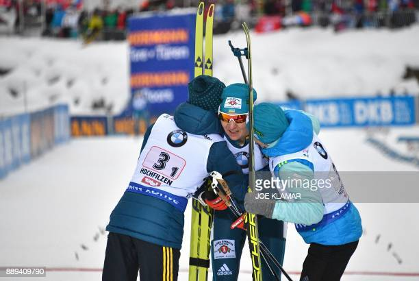 Ukraine's Vita Semerenko Olena Pidhrushna and Valj Semerenko celebrate their second place during the women's 4x6 km relay event at the IBU World Cup...
