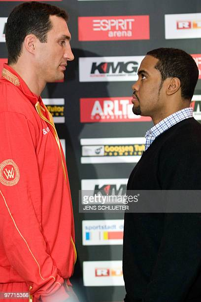 Ukraine's Vladimir Klitschko and USA's Eddie Chambers face each other during their press conference on March 15 2010 in Duesseldorf ahead of their...