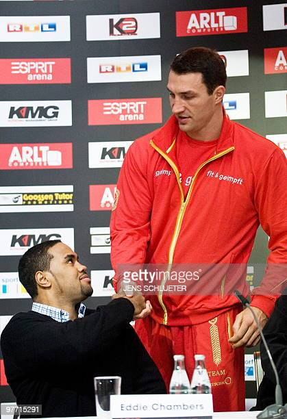 Ukraine's Vladimir Klitschko and USA's Eddie Chambers greet each other ahead of their press conference on March 15 2010 in Duesseldorf ahead of their...