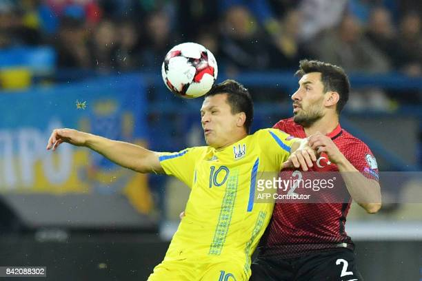 Ukraine's Yevhen Konoplyanka vies with Turkey's Sener Ozbayrakli during the FIFA World Cup 2018 qualification football match between Ukraine and...