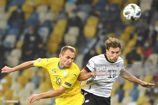 Ukraine's Yevhen Makarenko and Germany's Leon Goretzka vie for the ball during the UEFA Nations League football match between Ukraine and Germany at...