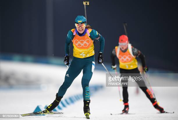 Ukraine's Yuliia Dzhima and Germany's Franziska Hildebrand compete in the women's 4x6km biathlon event during the Pyeongchang 2018 Winter Olympic...
