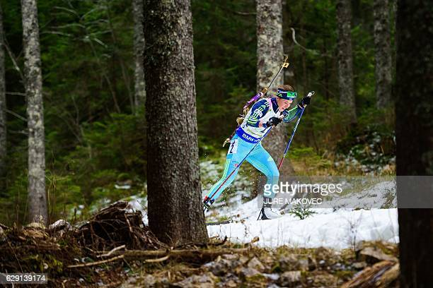 Ukraine's Yuliia Dzhima competes during during Women's 4x6 km relay race of the IBU Biathlon World Cup in Pokljuka Slovenia on December 11 2016 / AFP...