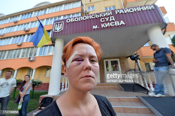 Ukrainian activist and founder of FEMEN Anna Hutsol is pictured in front a district court in Kiev on July 28 2013 after being allegedly assault the...