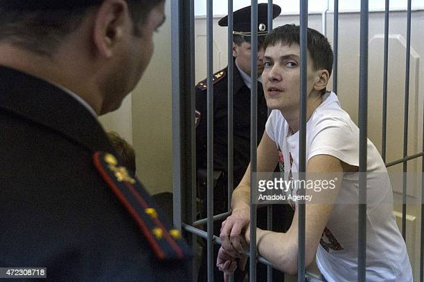 Ukrainian air force pilot Nadia Savchenko stands in a cage at a court room at the Basmanny District Court in Moscow Russia on March 26 2015