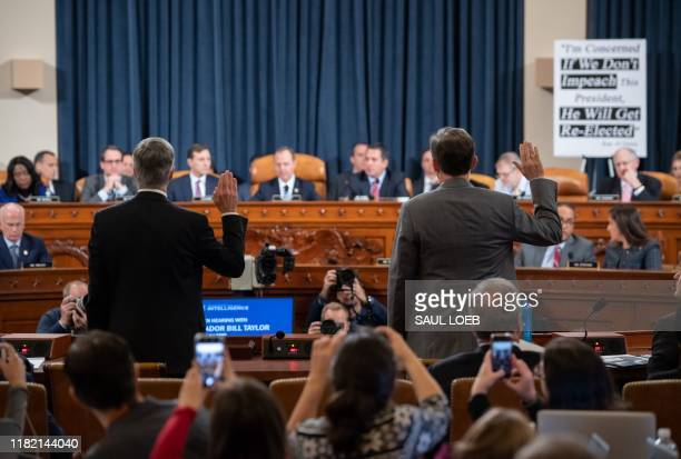 Ukrainian Ambassador William Taylor and Deputy Assistant Secretary George Kent are swornin prior to testifying during the first public hearings held...