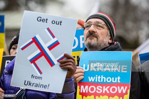 Ukrainian and Polish people protest in front of Russian embassy against Russian military action the Crimean peninsula during a propeace demonstration...