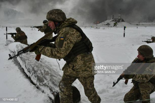 Ukrainian army reservists take part in military exercises in the Army Training Center near the village of Desna Chernigiv region on December 19 2018...