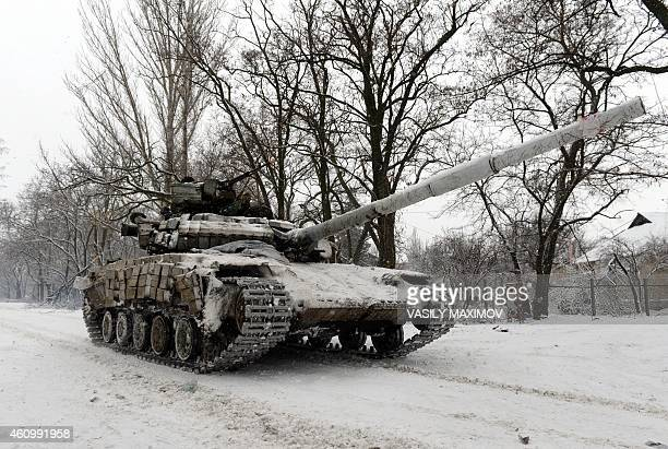 A Ukrainian Army tank rides on January 3 2015 near the eastern Ukrainian village of Pisky in the northeastern Donetsk region AFP PHOTO / VASILY...