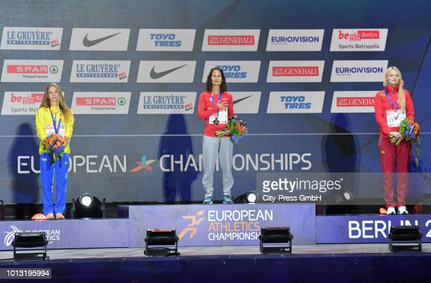Ukrainian athlete Alina Tsviliy portuguese athlete Inês Henriques and spanish athlete Julia Takács during the winner ceremony of the men's and...