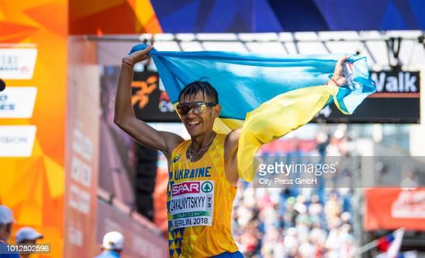 Ukrainian athlete Maryan Zakalnytskyy celebrates winning the men's and women's 50km final race during the European Athletics Championships Berlin...