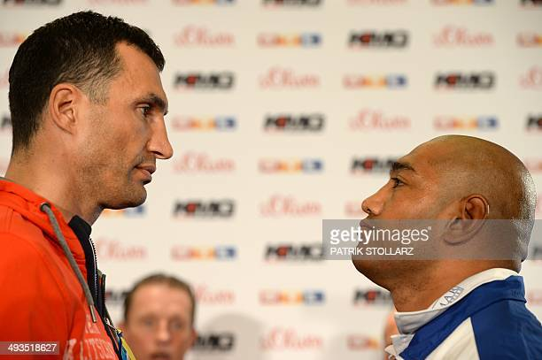 Ukrainian born world heavyweight boxing champion Wladimir Klitschko faces his challenger Australia's Alex Leapai during a press conference in...