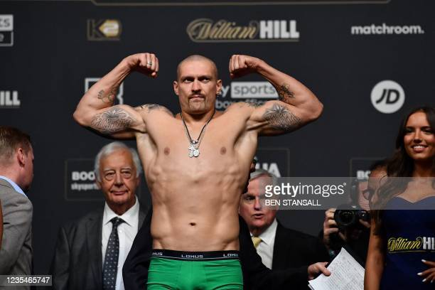 Ukrainian boxer Oleksandr Usyk gestures during his weigh-in at the O2 arena ahead of his bout with British heavyweight champion boxer Anthony Joshua,...