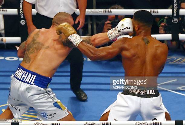 Ukrainian boxer Oleksandr Usyk lands a punch against British heavyweight champion boxer Anthony Joshua during their heavyweight boxing match at...