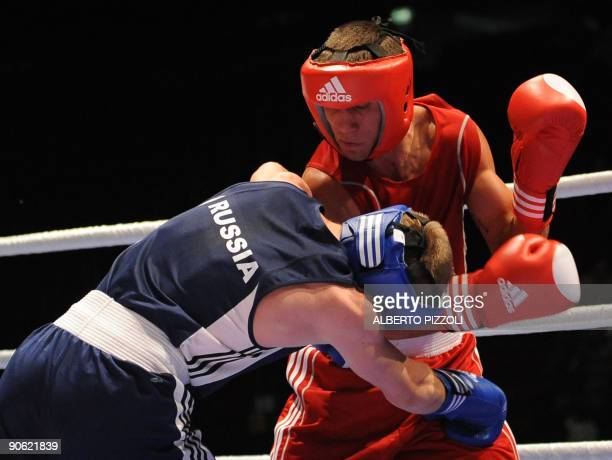 Ukrainian boxer Vasyl Lomachenko and Russian boxer Sergey Vodopiyanov fight during their Feather 57 kg final of the AIBA World Boxing Cup at the...