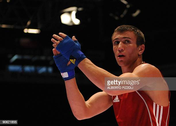 Ukrainian boxer Vasyl Lomachenko celebrates after winning the world title of Feather 57kg during the AIBA World Boxing Cup at the Assago forum in...