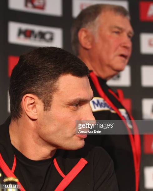 Ukrainian boxer Vitali Klitschko and his coach Fritz Sdunek attend a press conference at Westin Grand hotel on February 13 2012 in Munich Germany...