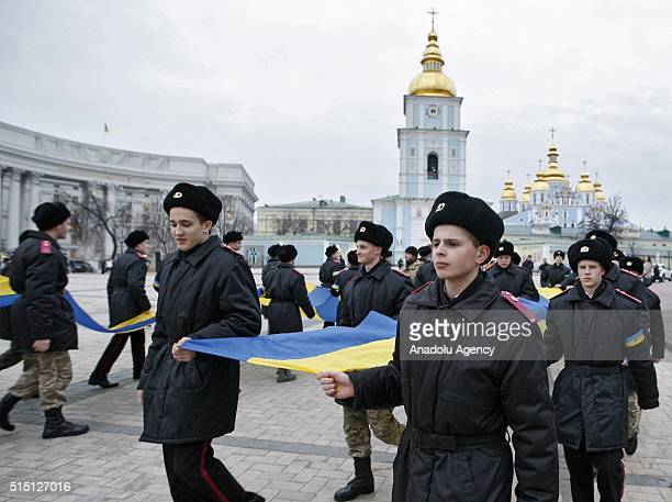 Ukrainian cadets hold a large flag of Ukraine during a patriotic rally called 'Unity Day Ukraine it's me ' in Kiev Ukraine on March 12 2016