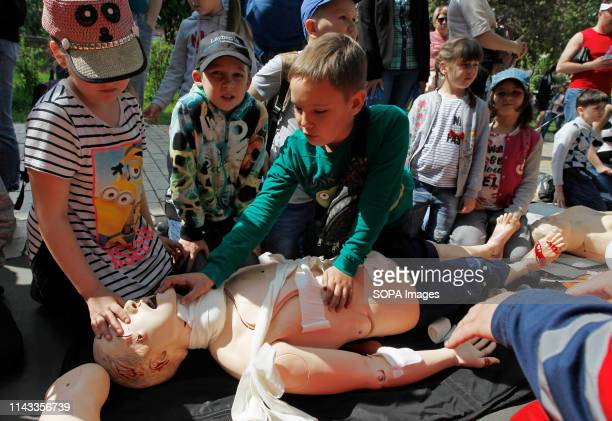 Ukrainian children seen learning about first aid during the festival. Children festival also called City of professions. The festival is a children's...