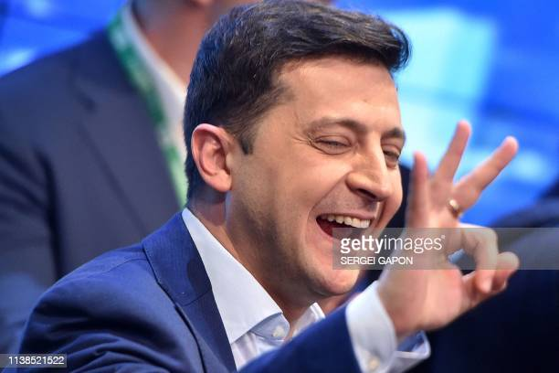Ukrainian comedian and presidential candidate Volodymyr Zelensky reacts after the announcement of the first exit poll results in the second round of...