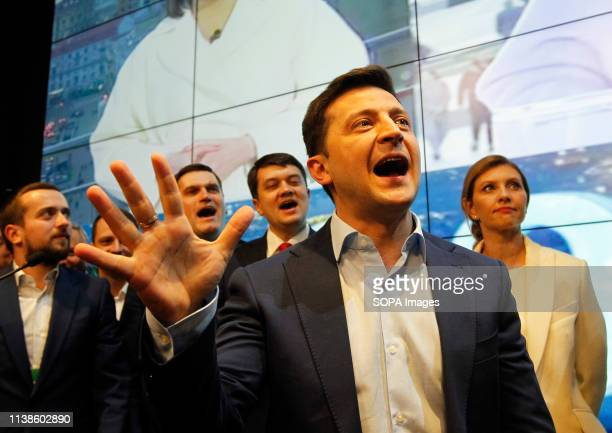 Ukrainian comic actor and presidential candidate Volodymyr Zelensky is seen reacting as he sees the first exit poll results at his campaign...
