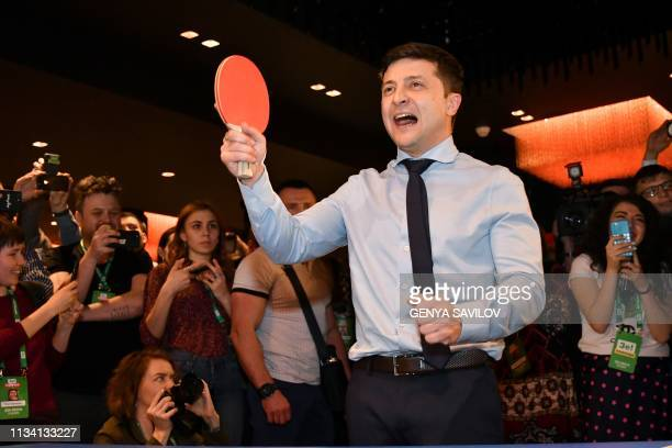 TOPSHOT Ukrainian comic actor showman and presidential frontrunner Volodymyr Zelensky surrounded by cameramen and photographers plays table tennis...