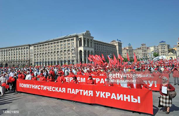 Ukrainian Communist Party activists march in Kiev to mark May Day on May 1 2012 AFP PHOTO/ SERGEI SUPINSKY