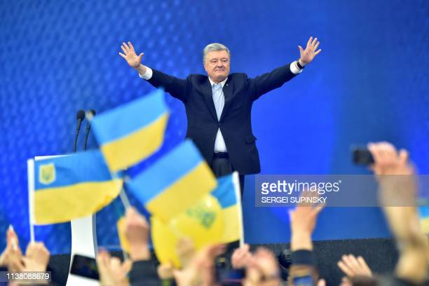 Ukrainian current President and presidential candidate Petro Poroshenko greets his supporters during a presidential election debate at Kiev's Olympic...