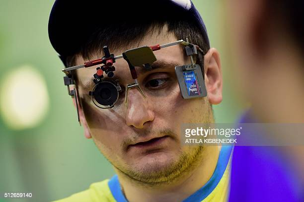 Ukrainian Denys Kushnirov vies in his break time in AUDI Arena of Gyor during the qualification round of 10m air pistol category for men on February...