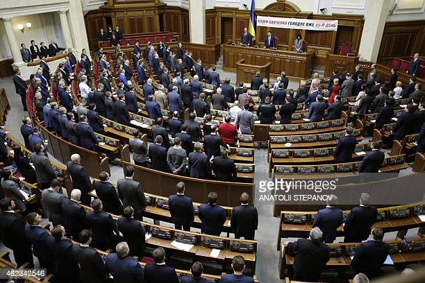 Ukrainian deputies stand up on January 27 2015 in the parliament in Kiev to mark the 70th anniversary of the liberation of the Auschwitz...