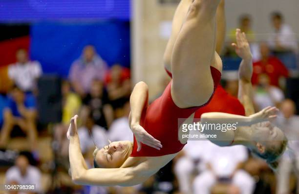Ukrainian divers Hanna Pysmenska and Olena Fedorova dive during the women's threemeter board synchronized at the European Diving Championships at...