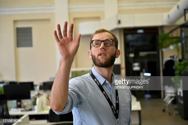 Ukrainian entrepreneur Dmytro Voloshyn gestures as he talks with AFP journalist in his empty office in Kiev on April 2 2020 Preply network now has...