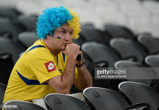 Ukrainian fan reacts after the Euro 2012 football championships match England vs Ukraine on June 19 2012 at the Donbass Arena in Donetsk AFP PHOTO /...